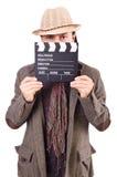 Hombre con clapperboard de la película Imagen de archivo