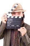 Hombre con clapperboard de la película Foto de archivo