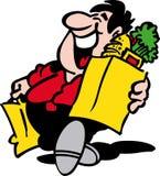 Hombre con compras Imagen de archivo libre de regalías