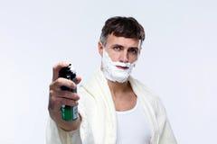 Hombre con crema de afeitar Fotografía de archivo