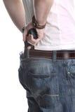Hombre con del arma la parte posterior detrás Foto de archivo libre de regalías