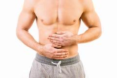 Hombre con dolor de estómago Imagen de archivo libre de regalías