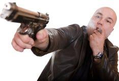 Hombre con el arma Imagen de archivo libre de regalías