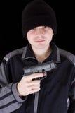 Hombre con el arma Foto de archivo