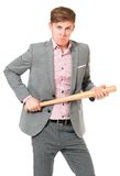 Hombre con el bate de béisbol Imagenes de archivo