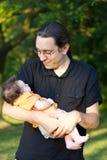Hombre con el bebé Fotografía de archivo