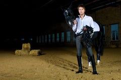 Hombre con el caballo Fotografía de archivo libre de regalías