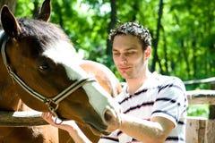 Hombre con el caballo Imagen de archivo libre de regalías