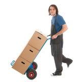 Hombre con el camión de mano Foto de archivo libre de regalías