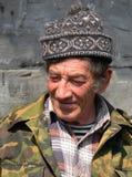 Hombre con el casquillo Foto de archivo