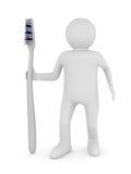 Hombre con el cepillo de dientes. 3D aislado Fotografía de archivo libre de regalías