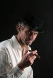 Hombre con el cigare Imágenes de archivo libres de regalías