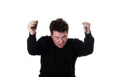 Hombre con el cuchillo y la granada de mano. Imagenes de archivo