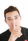 Hombre con el dedo en su boca Foto de archivo libre de regalías