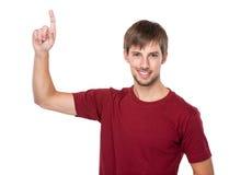 Hombre con el destacar del finger Fotografía de archivo libre de regalías