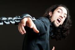 Hombre con el encadenamiento del metal Fotografía de archivo libre de regalías