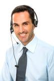 hombre con el funcionamiento de las auriculares como operador de centro de atención telefónica Imágenes de archivo libres de regalías