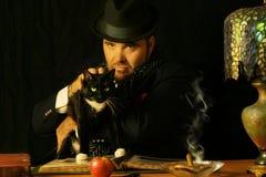 Hombre con el gato Imagen de archivo