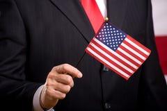 Hombre con el indicador americano Foto de archivo libre de regalías