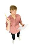 Hombre con el lápiz y la hoja del papel Foto de archivo