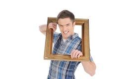 Hombre con el marco. Foto de archivo