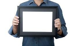 Hombre con el marco azul del negro del control de la camisa de la mezclilla foto de archivo