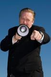 Hombre con el megáfono. Fotografía de archivo libre de regalías