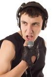 Hombre con el micrófono fotografía de archivo