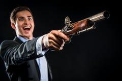 Hombre con el mosquete Imagen de archivo libre de regalías