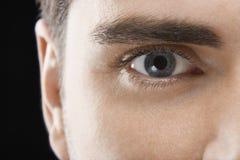 Hombre con el ojo azul imagen de archivo libre de regalías