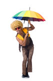 Hombre con el paraguas aislado Foto de archivo