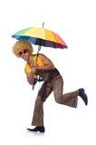 Hombre con el paraguas aislado Fotos de archivo