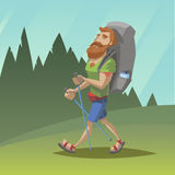 Hombre con el paseo rojo de la barba a través del campo Fotos de archivo