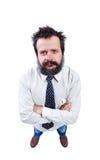 Hombre con el pelo divertido y la barba espesa que miran para arriba Imagen de archivo libre de regalías