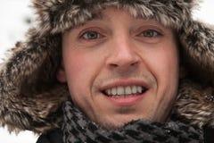 Hombre con el piel-casquillo Foto de archivo libre de regalías