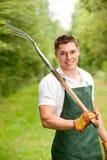 Hombre con el pitchfork Imagen de archivo libre de regalías