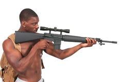 Hombre con el rifle de asalto Imagen de archivo libre de regalías