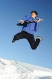 Hombre con el salto de la guitarra Fotos de archivo libres de regalías