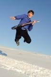 Hombre con el salto de la guitarra Imagen de archivo