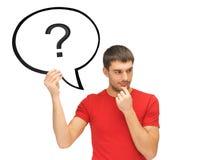 Hombre con el signo de interrogación en burbuja del texto Imágenes de archivo libres de regalías