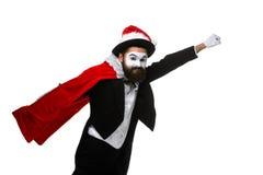 Hombre con el sombrero de la Navidad y el saco de Papá Noel Imagen de archivo libre de regalías