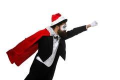 Hombre con el sombrero de la Navidad y el saco de Papá Noel Imagenes de archivo