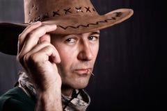 Hombre con el sombrero de vaquero imagenes de archivo