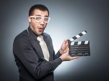Hombre con el tablero de chapaleta del movir foto de archivo libre de regalías