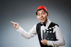 Hombre con el tablero de la película Imagen de archivo