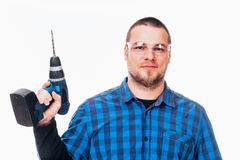 Hombre con el taladro eléctrico Imagen de archivo libre de regalías
