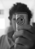 Hombre con el teléfono celular Foto de archivo libre de regalías