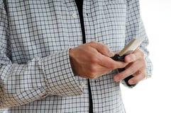 Hombre con el teléfono móvil Foto de archivo libre de regalías