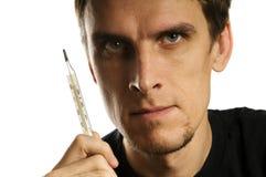 Hombre con el termómetro Foto de archivo libre de regalías