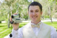 Hombre con el videocámera Foto de archivo libre de regalías